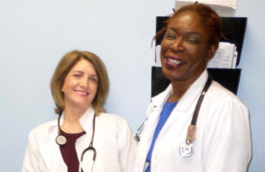 Two woman doctors smiling